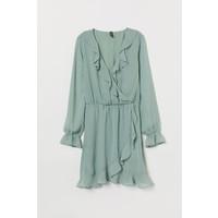 H&M Krótka sukienka kopertowa 0709269003 Bladozielony/Białe kropki