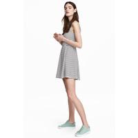 H&M Dżersejowa sukienka 0467302028 Biały/Czarne paski