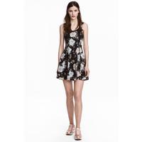 H&M Dżersejowa sukienka 0467302028 Czarny/Kwiaty