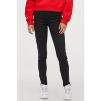 H&M Spodnie Skinny Fit 0562245006 Prawie czarny