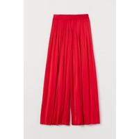 H&M Plisowane spodnie z satyny 0777033002 Czerwony