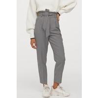 H&M Spodnie z talią paper bag 0753737016 Czarny/Pepitka