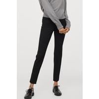 H&M Elastyczne spodnie 0655784003 Czarny
