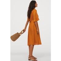 H&M Sukienka z lyocellu 0822158002 Ciemnożółty