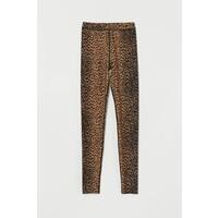 H&M Błyszczące legginsy 0807064003 Brązowy/Panterka