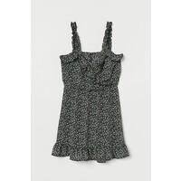 H&M Kopertowa sukienka z falbaną 0895506002 Czarny/Drobne kwiaty