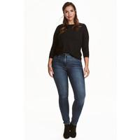 H&M H&M+ Elastyczne spodnie 0352811006 Ciemnoniebieski denim