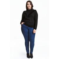 H&M H&M+ Elastyczne spodnie 0352811006 Ciemnoniebieski denim/Raw