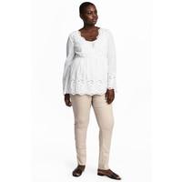 H&M H&M+ Elastyczne spodnie 0352811006 Jasnobeżowy
