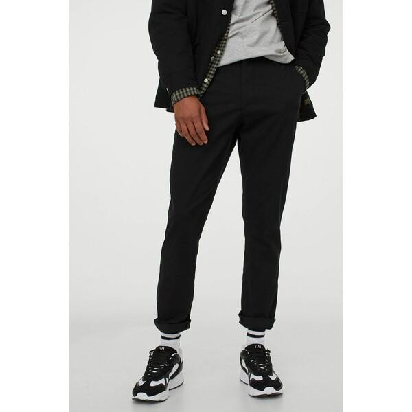 H&M Spodnie chinos Skinny fit 0710876028 Czarny